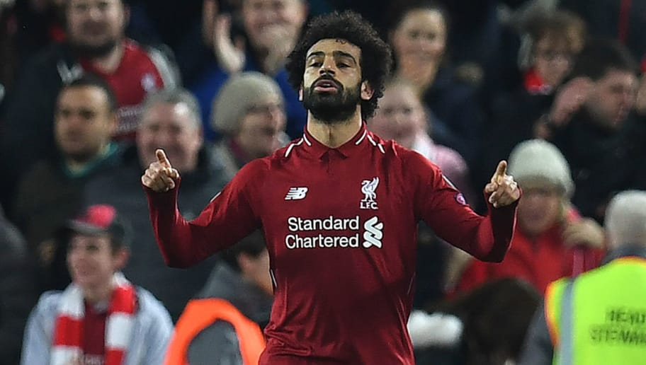 Liverpool's Egyptian midfielder Mohamed Salah celebrates scoring the opening goal during the UEFA Champions League group C football match between Liverpool and Napoli at Anfield stadium in Liverpool, north west England on December 11, 2018. (Photo by Paul ELLIS / AFP)        (Photo credit should read PAUL ELLIS/AFP/Getty Images)