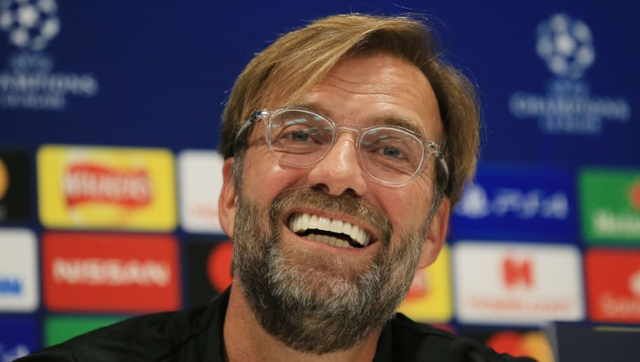 Liverpool's German manager Jurgen Klopp smiles during a press conference at Anfield Stadium in Liverpool, north west England, on October 23, 2018, on the eve of their UEFA Champions League group C football match against Red Star Belgrade. (Photo by Lindsey PARNABY / AFP)        (Photo credit should read LINDSEY PARNABY/AFP/Getty Images)
