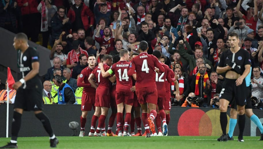 Liverpool's English striker Daniel Sturridge celebrates with teammates after scoring the team's first goal during the UEFA Champions League group C football match between Liverpool and Paris Saint-Germain at Anfield in Liverpool, north west England on September 18, 2018. (Photo by Paul ELLIS / AFP)        (Photo credit should read PAUL ELLIS/AFP/Getty Images)