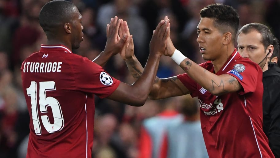Liverpool's Brazilian midfielder Roberto Firmino (R) replaces Liverpool's English striker Daniel Sturridge during the UEFA Champions League group C football match between Liverpool and Paris Saint-Germain at Anfield in Liverpool, north west England on September 18, 2018. (Photo by Paul ELLIS / AFP)        (Photo credit should read PAUL ELLIS/AFP/Getty Images)