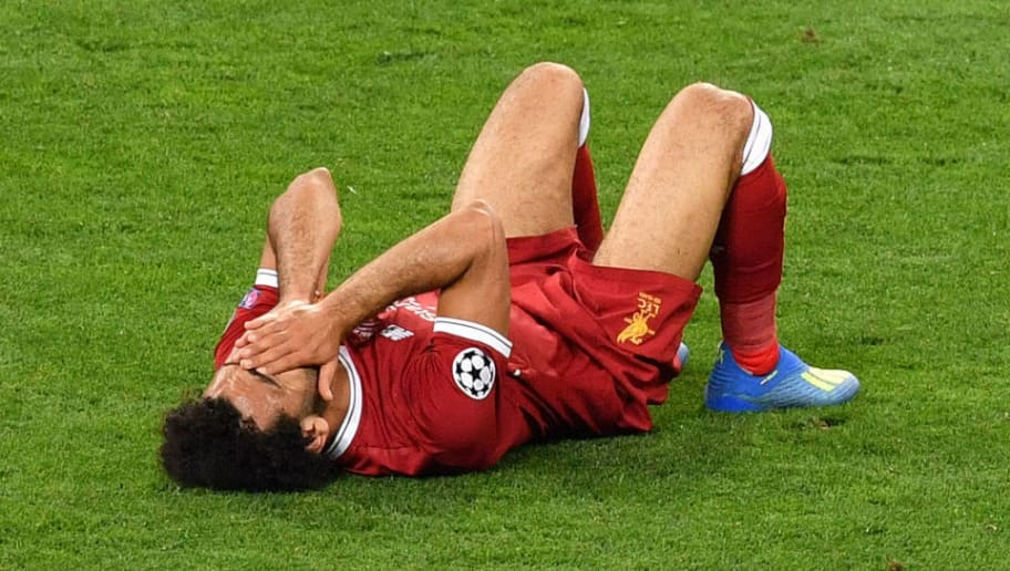 Liverpool's Egyptian forward Mohamed Salah lays on the pitch following injury during the UEFA Champions League final football match between Liverpool and Real Madrid at the Olympic Stadium in Kiev, Ukraine on May 26, 2018. (Photo by Sergei SUPINSKY / AFP)        (Photo credit should read SERGEI SUPINSKY/AFP/Getty Images)