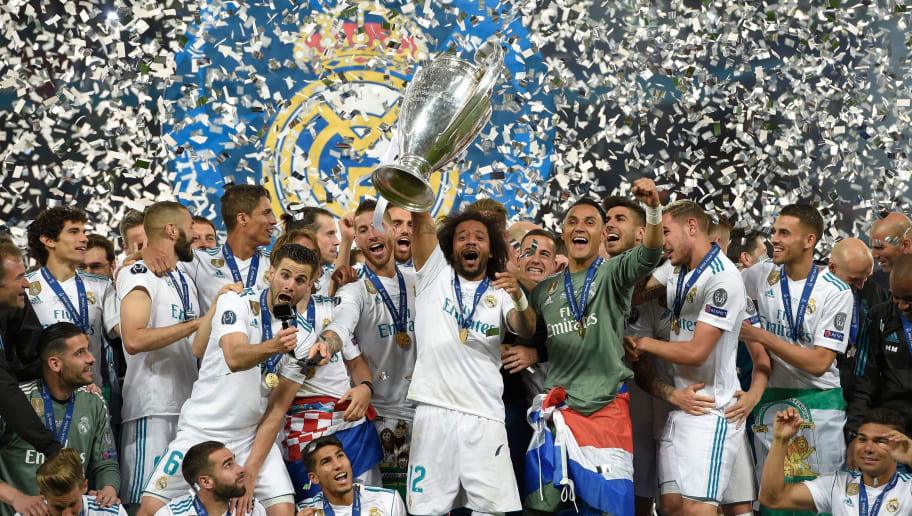 Real Madrid's Brazilian defender Marcelo (C) lifts the trophy after winning the UEFA Champions League final football match between Liverpool and Real Madrid at the Olympic Stadium in Kiev, Ukraine on May 26, 2018. - Real Madrid defeated Liverpool 3-1. (Photo by LLUIS GENE / AFP)        (Photo credit should read LLUIS GENE/AFP/Getty Images)