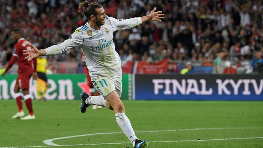 Real Madrid's Welsh forward Gareth Bale celebrates after scoring his second goal during the UEFA Champions League final football match between Liverpool and Real Madrid at the Olympic Stadium in Kiev, Ukraine on May 26, 2018. (Photo by LLUIS GENE / AFP)        (Photo credit should read LLUIS GENE/AFP/Getty Images)