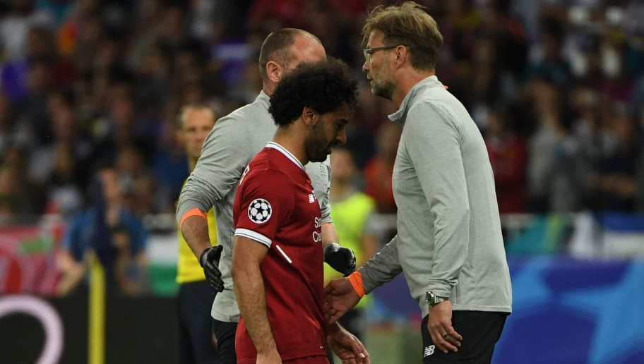 Liverpool's German manager Jurgen Klopp gestures to Liverpool's Egyptian forward Mohamed Salah, forced the leave the pitch after hurting his shoulder in a challenge with Real Madrid's Spanish defender Sergio Ramos during the UEFA Champions League final football match between Liverpool and Real Madrid at the Olympic Stadium in Kiev, Ukraine on May 26, 2018. (Photo by Paul ELLIS / AFP)        (Photo credit should read PAUL ELLIS/AFP/Getty Images)
