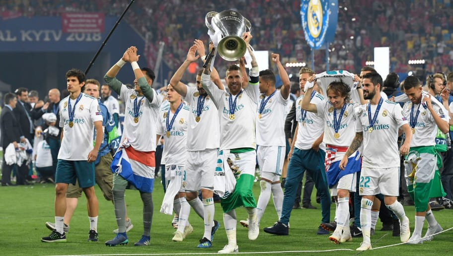 Real Madrid's Spanish defender Sergio Ramos (C) lifts the trophy after winning the UEFA Champions League final football match between Liverpool and Real Madrid at the Olympic Stadium in Kiev, Ukraine on May 26, 2018. - Real Madrid defeated Liverpool 3-1. (Photo by LLUIS GENE / AFP)        (Photo credit should read LLUIS GENE/AFP/Getty Images)