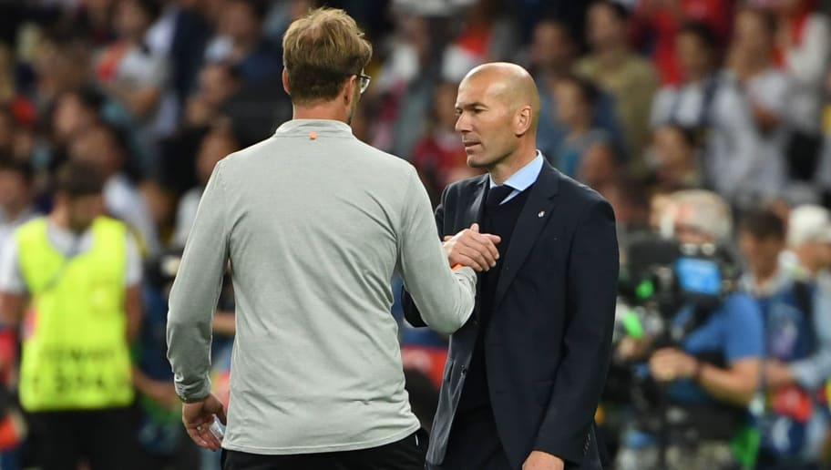 Real Madrid's French coach Zinedine Zidane (R) shakes hands with Liverpool's German manager Jurgen Klopp towards the end of the UEFA Champions League final football match between Liverpool and Real Madrid at the Olympic Stadium in Kiev, Ukraine on May 26, 2018. - Real Madrid won the game 3-1. (Photo by Paul ELLIS / AFP)        (Photo credit should read PAUL ELLIS/AFP/Getty Images)