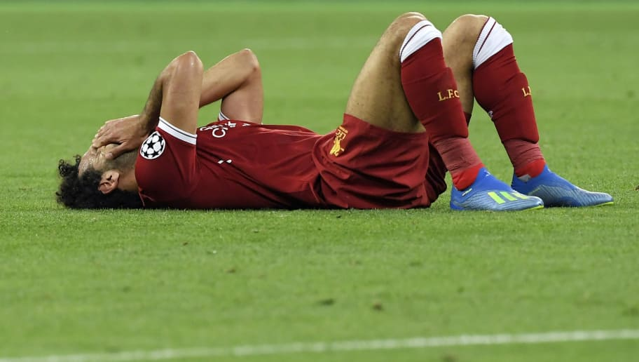 Liverpool's Egyptian forward Mohamed Salah gestures after suffering an injury during the UEFA Champions League final football match between Liverpool and Real Madrid at the Olympic Stadium in Kiev, Ukraine on May 26, 2018. (Photo by LLUIS GENE / AFP)        (Photo credit should read LLUIS GENE/AFP/Getty Images)