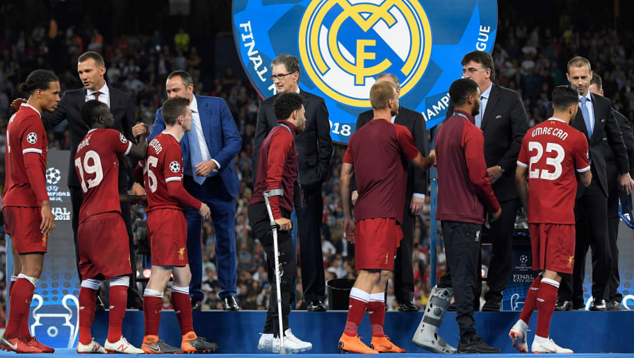 Liverpool's players receive their silver medals after the UEFA Champions League final football match between Liverpool and Real Madrid at the Olympic Stadium in Kiev, Ukraine on May 26, 2018. - Real Madrid defeated Liverpool 3-1. (Photo by LLUIS GENE / AFP)        (Photo credit should read LLUIS GENE/AFP/Getty Images)