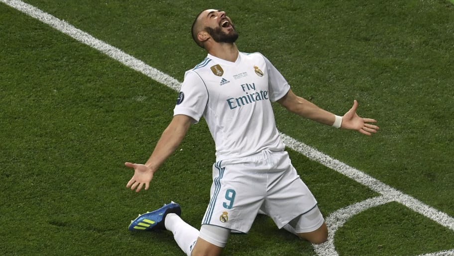 Real Madrid's French forward Karim Benzema celebrates after scoring the 0-1 during the UEFA Champions League final football match between Liverpool and Real Madrid at the Olympic Stadium in Kiev, Ukraine on May 26, 2018. (Photo by Sergei SUPINSKY / AFP)        (Photo credit should read SERGEI SUPINSKY/AFP/Getty Images)