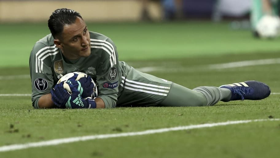 Real Madrid's Costa Rican goalkeeper Keylor Navas grabs the ball during the UEFA Champions League final football match between Liverpool and Real Madrid at the Olympic Stadium in Kiev, Ukraine on May 26, 2018. (Photo by Isabella BONOTTO / Update Images Press / AFP)        (Photo credit should read ISABELLA BONOTTO/AFP/Getty Images)
