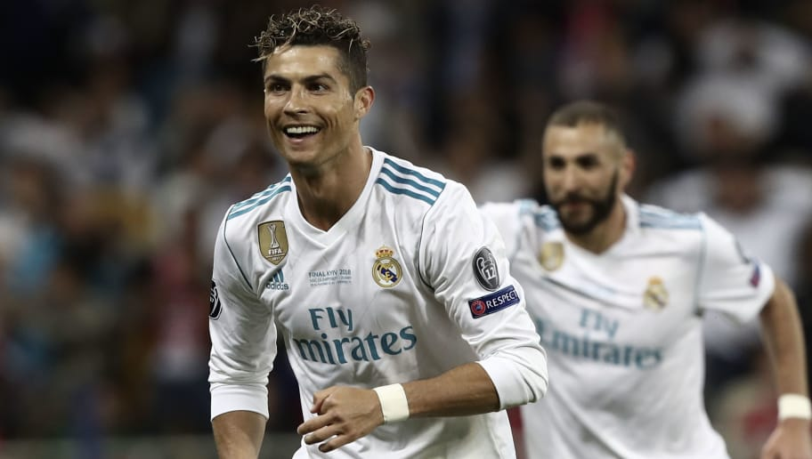 Real Madrid's Portuguese forward Cristiano Ronaldo (L) cele brates after Real Madrid's Welsh forward Gareth Bale scored a goal during the UEFA Champions League final football match between Liverpool and Real Madrid at the Olympic Stadium in Kiev, Ukraine on May 26, 2018. (Photo by Isabella BONOTTO / Update Images Press / AFP)        (Photo credit should read ISABELLA BONOTTO/AFP/Getty Images)