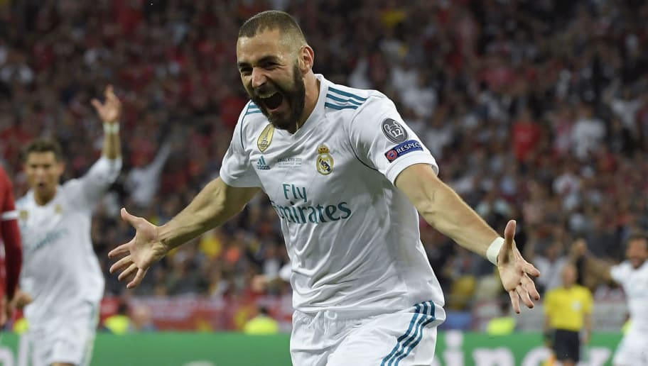 Real Madrid's French forward Karim Benzema celebrates after scoring a goal during the UEFA Champions League final football match between Liverpool and Real Madrid at the Olympic Stadium in Kiev, Ukraine on May 26, 2018. (Photo by LLUIS GENE / AFP)        (Photo credit should read LLUIS GENE/AFP/Getty Images)