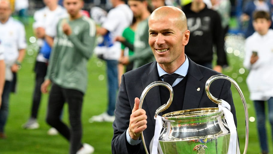Real Madrid's French coach Zinedine Zidane poses with the trophy after winning  the UEFA Champions League final football match between Liverpool and Real Madrid at the Olympic Stadium in Kiev, Ukraine, on May 26, 2018. (Photo by GENYA SAVILOV / AFP)        (Photo credit should read GENYA SAVILOV/AFP/Getty Images)