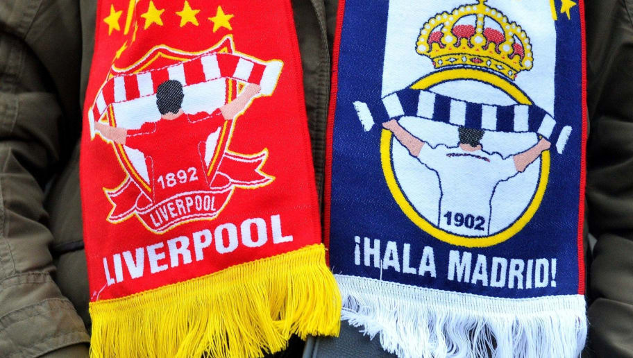 A fan wears a match on the approach to the stadium ahead of the UEFA Champions League group B football match between Liverpool and Real Madrid at Anfield in Liverpool, northwest, England on October 22, 2014. AFP PHOTO / PAUL ELLIS        (Photo credit should read PAUL ELLIS/AFP/Getty Images)