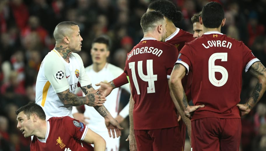 Roma's Belgian midfielder Radja Nainggolan (L) gestures for a hand ball against Liverpool's English midfielder James Milner (down) during the UEFA Champions League first leg semi-final football match between Liverpool and Roma at Anfield stadium in Liverpool, north west England on April 24, 2018. (Photo by Filippo MONTEFORTE / AFP)        (Photo credit should read FILIPPO MONTEFORTE/AFP/Getty Images)