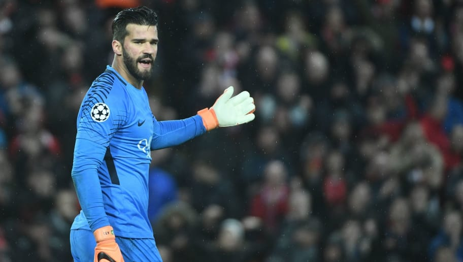 Roma's Brazilian goalkeeper Alisson gestures during the UEFA Champions League first leg semi-final football match between Liverpool and Roma at Anfield stadium in Liverpool, north west England on April 24, 2018. (Photo by Filippo MONTEFORTE / AFP)        (Photo credit should read FILIPPO MONTEFORTE/AFP/Getty Images)