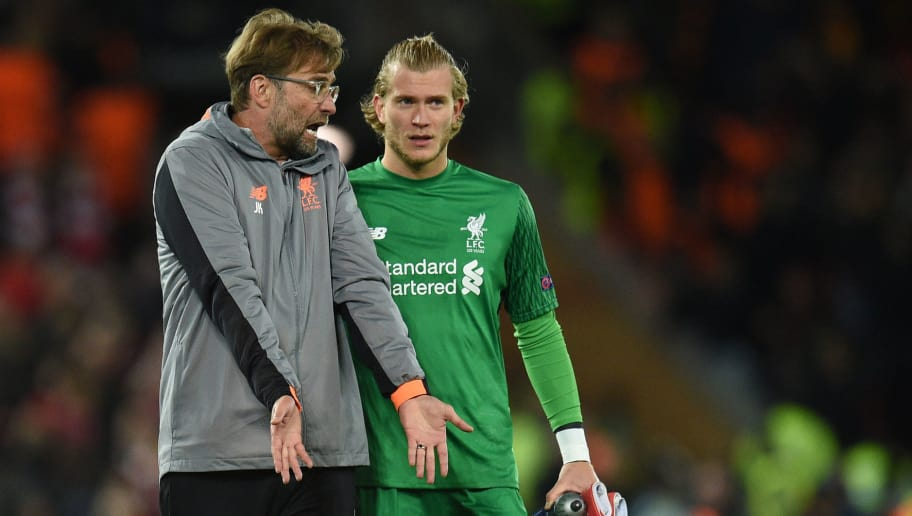 Liverpool's German manager Jurgen Klopp (L) talks with Liverpool's German goalkeeper Loris Karius after the UEFA Champions League first leg semi-final football match between Liverpool and Roma at Anfield stadium in Liverpool, north west England on April 24, 2018. (Photo by Oli SCARFF / AFP)        (Photo credit should read OLI SCARFF/AFP/Getty Images)