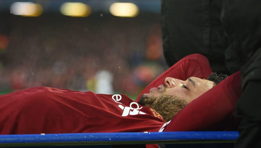 Liverpool's English midfielder Alex Oxlade-Chamberlain is stretchered off the pitch during the UEFA Champions League first leg semi-final football match between Liverpool and Roma at Anfield stadium in Liverpool, north west England on April 24, 2018. (Photo by Oli SCARFF / AFP)        (Photo credit should read OLI SCARFF/AFP/Getty Images)