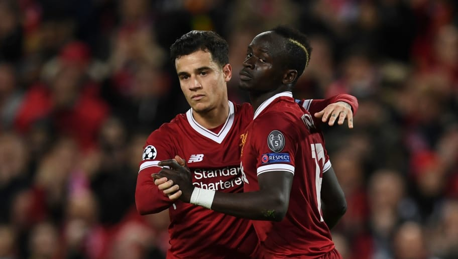 Liverpool's Senegalese midfielder Sadio Mane (R) celebrates scoring their sixth goal with Liverpool's Brazilian midfielder Philippe Coutinho (L) during the UEFA Champions League Group E football match between Liverpool and Spartak Moscow at Anfield in Liverpool, north-west England on December 6, 2017. / AFP PHOTO / Paul ELLIS        (Photo credit should read PAUL ELLIS/AFP/Getty Images)