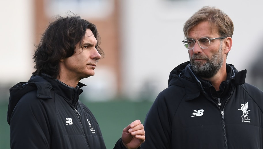 Liverpool's German manager Jurgen Klopp (R) and assistant manager Zeljko Buvac attend a team training session on the eve of the UEFA Champions League first leg quarter-final football match between Liverpool and Manchester City, at Melwood Training Ground in Liverpool, north west England on April 3, 2018. / AFP PHOTO / Paul ELLIS        (Photo credit should read PAUL ELLIS/AFP/Getty Images)