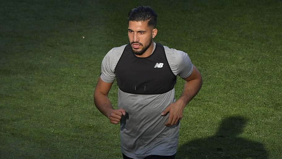 Liverpool's German midfielder Emre Can runs during a Liverpool team training session at the Olympic Stadium in Kiev, Ukraine on May 25, 2018, on the eve of the UEFA Champions League final football match between Liverpool and Real Madrid. (Photo by LLUIS GENE / AFP)        (Photo credit should read LLUIS GENE/AFP/Getty Images)