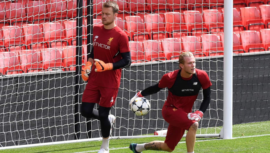 Liverpool's Belgian goalkeeper Simon Mignolet (L) and Liverpool's German goalkeeper Loris Karius attends a training session and media day at Anfield stadium in Liverpool, north west England on May 21, 2018, ahead of their UEFA Champions League final football match against Real Madrid in Kiev on May 26. (Photo by Paul ELLIS / AFP)        (Photo credit should read PAUL ELLIS/AFP/Getty Images)