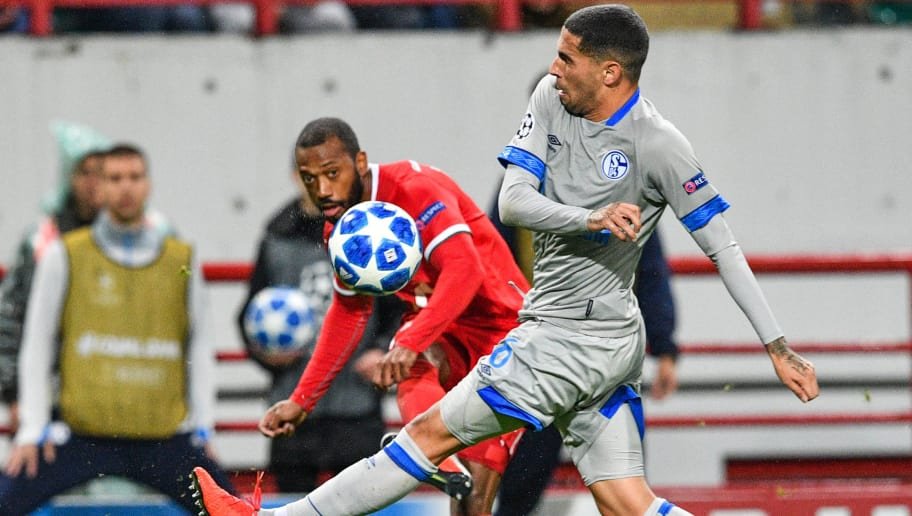 Lokomotiv Moscow's Portuguese midfielder Manuel Fernandes and Schalke's Spanish midfielder Omar Mascarell vie for the ball during the UEFA Champions League group D football match between FC Lokomotiv Moscow and FC Schalke 04 at the RZD Arena in Moscow on October 3, 2018. (Photo by Mladen ANTONOV / AFP)        (Photo credit should read MLADEN ANTONOV/AFP/Getty Images)
