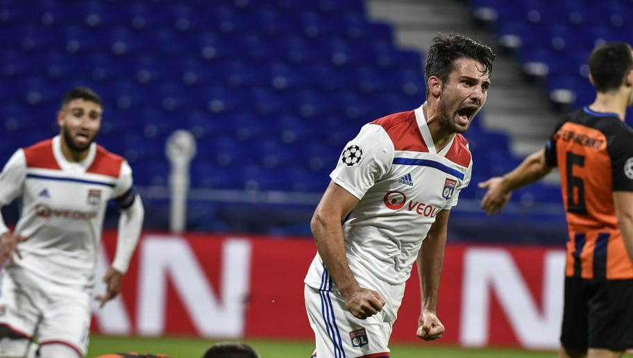 Lyon's French defender Leo Dubois (C) celebrates after scoring their second goal during their UEFA Champions League Group F football match Olympique Lyonnais vs FC Shakhtar Donetsk at the OL stadium in Decines-Charpieu on October 2, 2018. (Photo by JEFF PACHOUD / AFP)        (Photo credit should read JEFF PACHOUD/AFP/Getty Images)