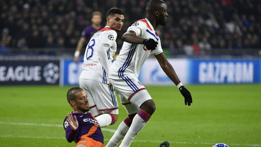 Manchester City's Spanish midfielder David Silva (C) vies with Lyon's French midfielder Tanguy Ndombele (R) and Lyon's forward Houssem Aouar (L) during the UEFA Champions League Group F football match between Olympique Lyonnais and Manchester City at the Parc Olympique Lyonnais stadium in Decines-Charpieu, central-eastern France, on November 27, 2018. (Photo by JEFF PACHOUD / AFP)        (Photo credit should read JEFF PACHOUD/AFP/Getty Images)