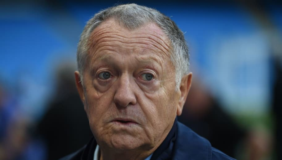 Lyon's president Jean-Michel Aulas attends a training session on the pitch at the Etihad Stadium in Manchester, north west England on September 18, 2018, on the eve of the UEFA Champions League first round football match between Manchester City and Lyon. (Photo by Oli SCARFF / AFP)        (Photo credit should read OLI SCARFF/AFP/Getty Images)