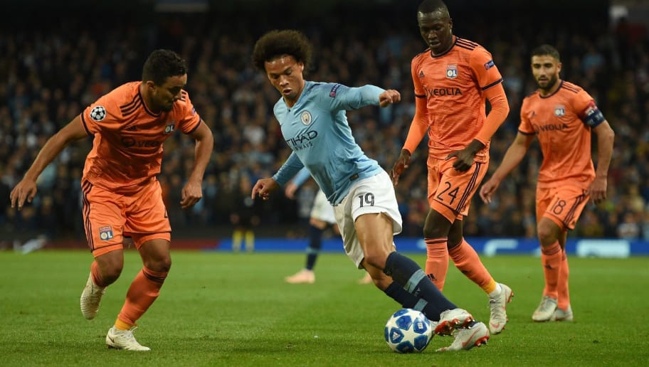 Manchester City's German midfielder Leroy Sane (C) controls the ball during the UEFA Champions League group F football match between Manchester City and Lyon at the Etihad Stadium in Manchester, north west England, on September 19, 2018. (Photo by Oli SCARFF / AFP)        (Photo credit should read OLI SCARFF/AFP/Getty Images)