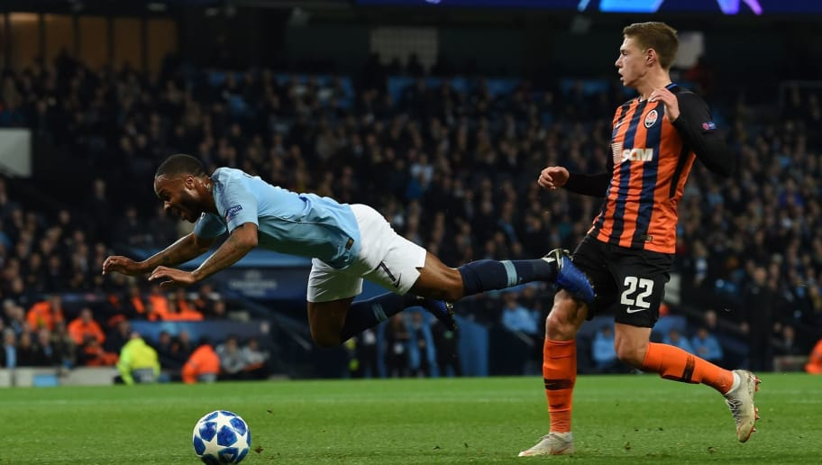 Manchester City's English midfielder Raheem Sterling (L) falls by Shakhtar Donetsk's Ukrainian defender Mykola Matviyenko to gain a penalty during a UEFA Champions League group F football match between Manchester City and Shakhtar Donetsk at the Etihad stadium in Manchester, northwest England on November 7, 2018. (Photo by Paul ELLIS / AFP)        (Photo credit should read PAUL ELLIS/AFP/Getty Images)
