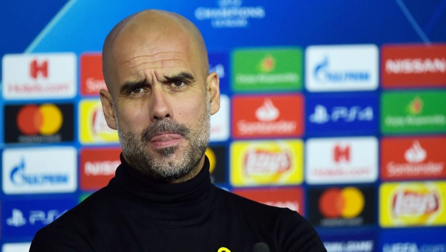 Manchester City's Spanish head coach Pep Guardiola looks on during a press conference at the Groupama stadium in Decines-Charpieu, central-eastern France on November 26, 2018, on the eve of the UEFA Champions League Group F football match between Olympique Lyonnais and Manchester City. (Photo by ROMAIN LAFABREGUE / AFP)        (Photo credit should read ROMAIN LAFABREGUE/AFP/Getty Images)