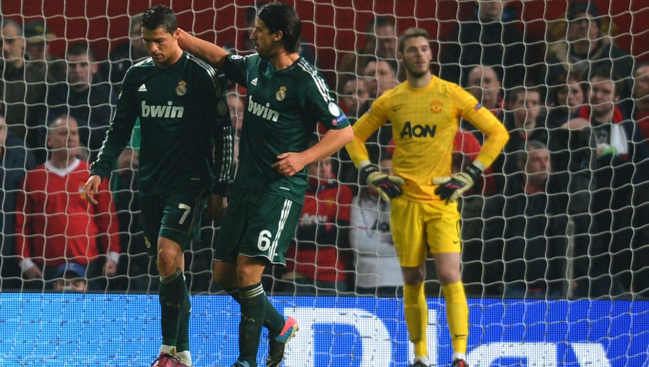 Real Madrid's Portuguese forward Cristiano Ronaldo (L) reacts after scoring his team's second goal as with Real Madrid's German midfielder Sami Khedira (R) during the UEFA Champions League round of 16 second leg football match between Manchester United and Real Madrid at Old Trafford in Manchester, northwest England on March 5, 2013. Real Madrid won 2-1 (3-2 on aggregate). AFP PHOTO / ANDREW YATES        (Photo credit should read ANDREW YATES/AFP/Getty Images)
