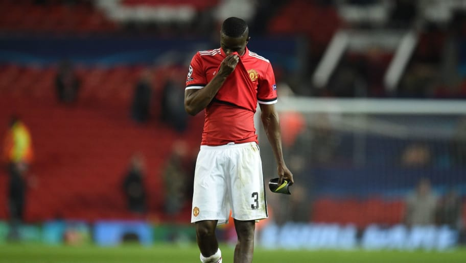 Manchester United's Ivorian defender Eric Bailly leaves the pitch after losing a last 16 second leg UEFA Champions League football match between Manchester United and Sevilla at Old Trafford in Manchester, northwest England on March 13, 2018. / AFP PHOTO / Oli SCARFF        (Photo credit should read OLI SCARFF/AFP/Getty Images)