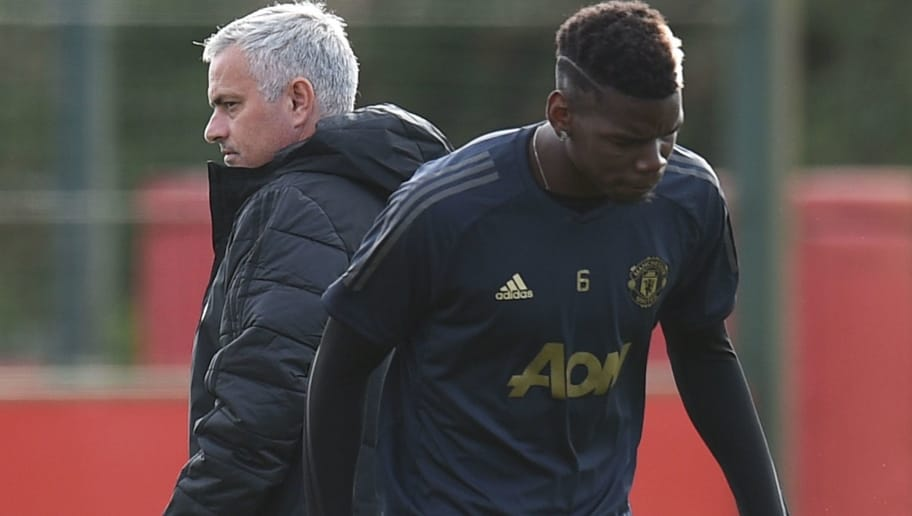 Manchester United's Portuguese manager Jose Mourinho (L) and Manchester United's French midfielder Paul Pogba (R) attend a training session at the Carrington Training complex in Manchester, north west England on October 22, 2018, ahead of their UEFA Champions League group H football match against Juventus on October 23. (Photo by Oli SCARFF / AFP)        (Photo credit should read OLI SCARFF/AFP/Getty Images)