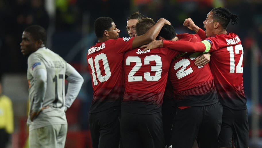 Manchester United's Belgian midfielder Marouane Fellaini (2R) celebrates scoring his team's first goal during the UEFA Champions League group H football match between Manchester United and Young Boys at Old Trafford in Manchester, north-west England on November 27, 2018. (Photo by Oli SCARFF / AFP)        (Photo credit should read OLI SCARFF/AFP/Getty Images)