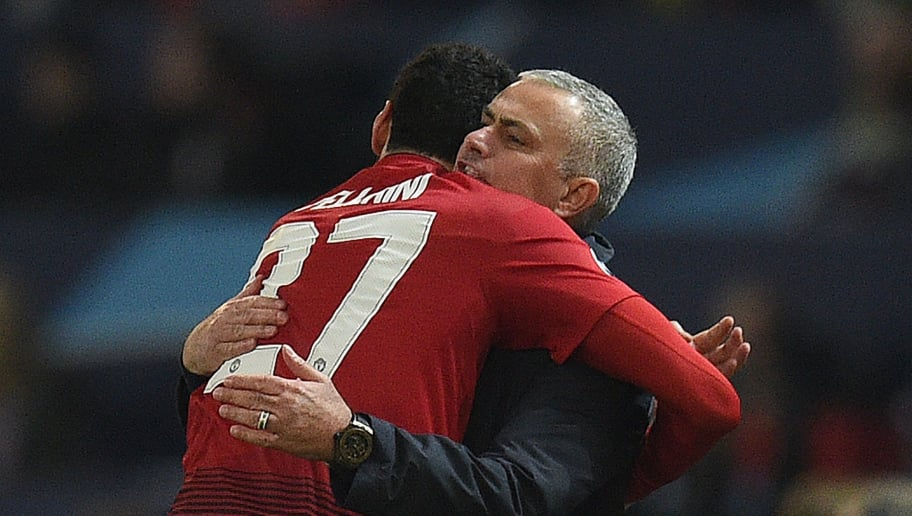 Manchester United's Belgian midfielder Marouane Fellaini (L) celebrates scoring the opening goal with Manchester United's Portuguese manager Jose Mourinho during the UEFA Champions League group H football match between Manchester United and Young Boys at Old Trafford in Manchester, north-west England on November 27, 2018. (Photo by Oli SCARFF / AFP)        (Photo credit should read OLI SCARFF/AFP/Getty Images)