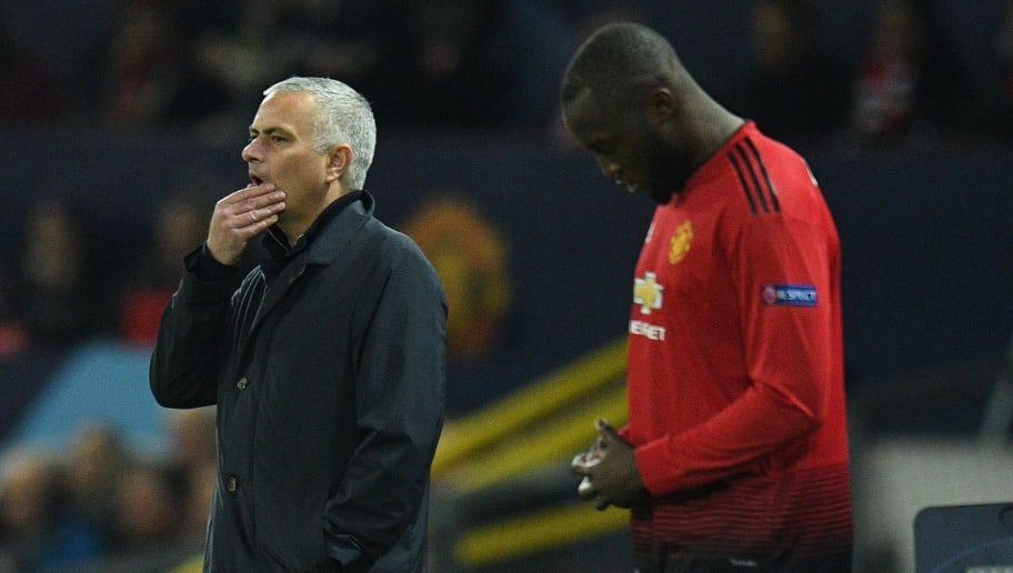 Manchester United's Portuguese manager Jose Mourinho (L) reacts as Manchester United's Belgian striker Romelu Lukaku waits to be substituted on during the UEFA Champions League group H football match between Manchester United and Young Boys at Old Trafford in Manchester, north-west England on November 27, 2018. (Photo by Oli SCARFF / AFP)        (Photo credit should read OLI SCARFF/AFP/Getty Images)