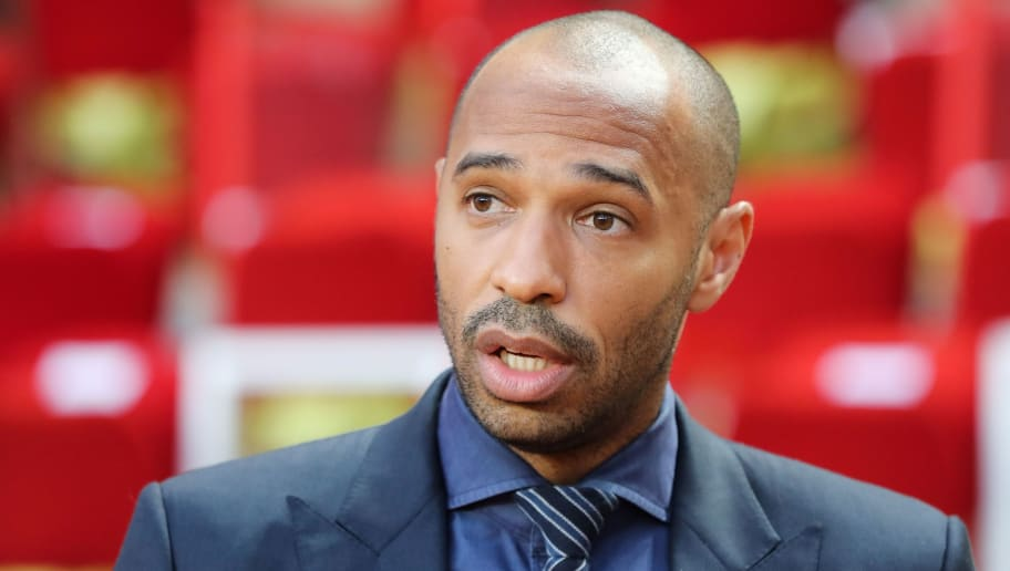 Belgium's national football team assistant coach Thierry Henry looks on prior to the UEFA Champions League first round football match between AS Monaco and Atletico Madrid at the Stade Louis II, in Monaco, on September 18, 2018. (Photo by Valery HACHE / AFP)        (Photo credit should read VALERY HACHE/AFP/Getty Images)