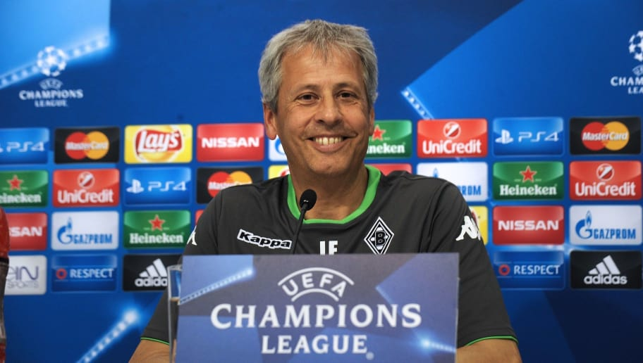 Borussia Monchengladbach's coach Lucien Favre smiles during a press conference at the Sanchez Pizjuan stadium in Sevilla on September 14, 2015, on the eve of the UEFA Champions League match Sevilla vs Borussia Monchengladbach. AFP PHOTO / CRISTINA QUICLER        (Photo credit should read CRISTINA QUICLER/AFP/Getty Images)