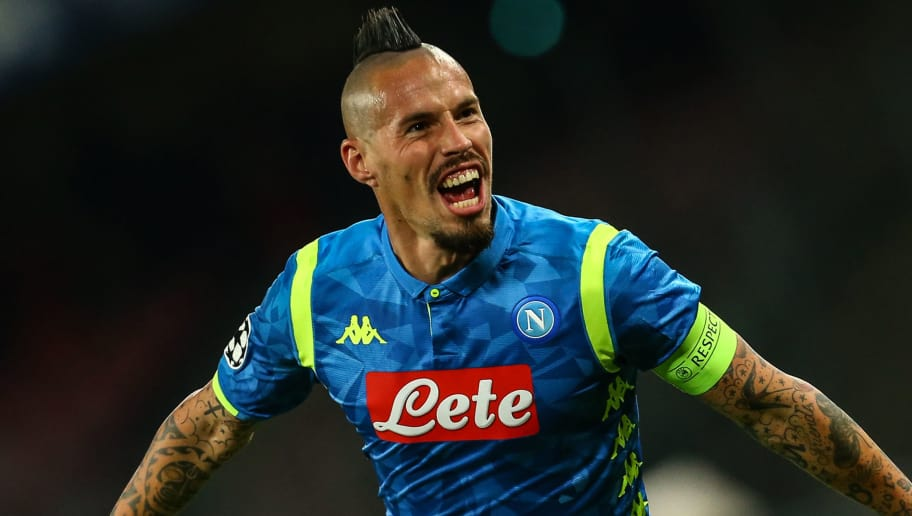 Napoli's Slovak midfielder Marek Hamsik celebrates after opening the scoring during the UEFA Champions League group C football match Napoli vs Red Star Belgrade on November 28, 2018 at the San Paolo stadium in Naples. (Photo by Carlo Hermann / AFP)        (Photo credit should read CARLO HERMANN/AFP/Getty Images)