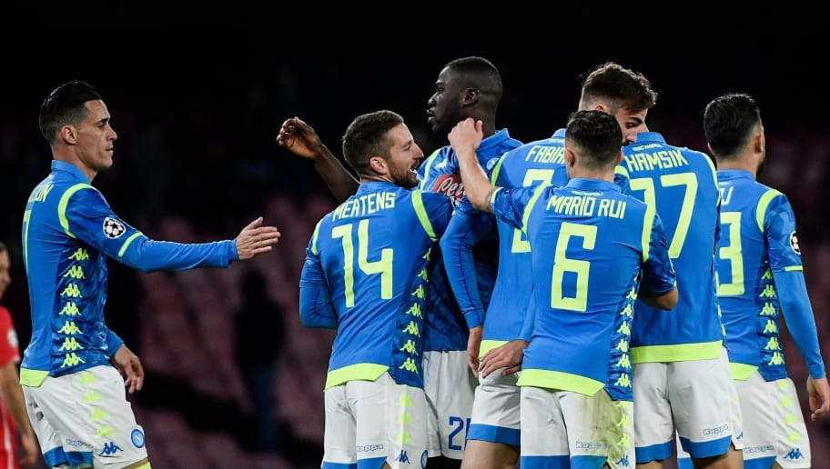 Napoli's Belgian forward Dries Mertens (C) celebrates with Napoli's Senegalese defender Kalidou Koulibaly (C-R), Napoli's Spanish forward Jose Callejon (L) and teammates after scoring during the UEFA Champions League group C football match Napoli vs Red Star Belgrade on November 28, 2018 at the San Paolo stadium in Naples. (Photo by Filippo MONTEFORTE / AFP)        (Photo credit should read FILIPPO MONTEFORTE/AFP/Getty Images)