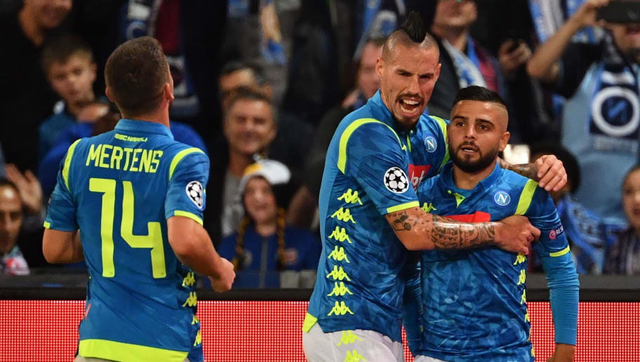 Napoli's Italian forward Lorenzo Insigne (R) is congratulated by Napoli's Slovak midfielder Marek Hamsik (C) after scoring a goal celebrates after scoring a goal during the European Champions League football match Napoli vs Paris Saint-Germain (PSG) on November 6, 2018 at San Paolo stadium in Naples. (Photo by Alberto PIZZOLI / AFP)        (Photo credit should read ALBERTO PIZZOLI/AFP/Getty Images)