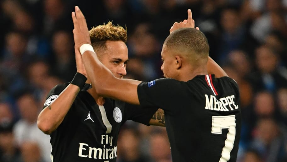 Paris Saint-Germain's Brazilian forward Neymar (L) and Paris Saint-Germain's French forward Kylian Mbappe (R) celebrate their team's goal during the European Champions League football match Napoli vs Paris Saint-Germain (PSG) on November 6, 2018 at San Paolo stadium in Naples. (Photo by Alberto PIZZOLI / AFP)        (Photo credit should read ALBERTO PIZZOLI/AFP/Getty Images)