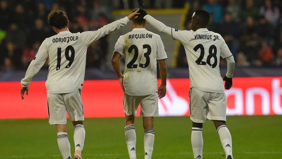 Real Madrid's Spanish defender Sergio Reguilon Rodriguez (C), Real Madrid's Spanish defender Alvaro Odriozola and Real Madrid's Brazilian forward Vinicius Jose Paixao de Oliveira Junior celebrate after scoring  during the UEFA Champions League group G football match Viktoria Plzen v Real Madrid in Plzen, Czech Republic on November 7, 2018. (Photo by Michal CIZEK / AFP)        (Photo credit should read MICHAL CIZEK/AFP/Getty Images)
