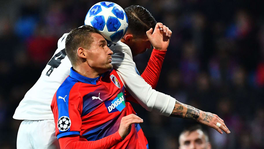 Real Madrid's Spanish defender Sergio Ramos and Viktoria Plzen's Czech defender Lukas Hejda vie for the ball during the UEFA Champions League group G football match Viktoria Plzen v Real Madrid in Plzen, Czech Republic on November 7, 2018. (Photo by JOE KLAMAR / AFP)        (Photo credit should read JOE KLAMAR/AFP/Getty Images)