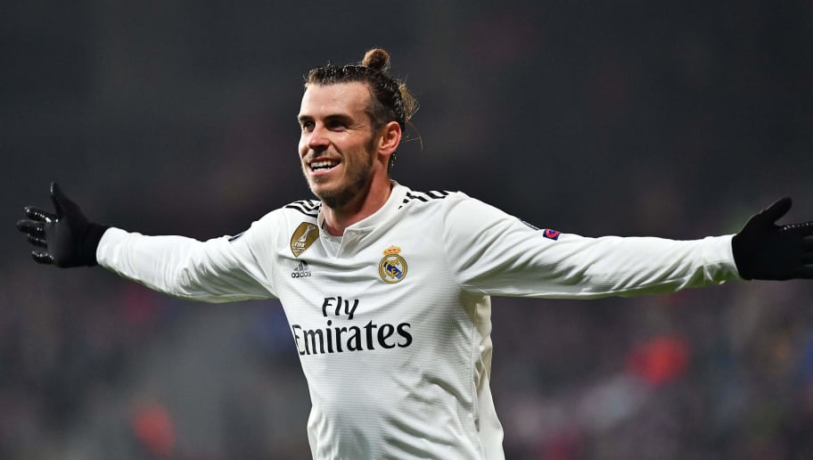 Real Madrid's Welsh forward Gareth Bale celebrates after scoring during the UEFA Champions League group G football match Viktoria Plzen v Real Madrid in Plzen, Czech Republic on November 7, 2018. (Photo by JOE KLAMAR / AFP)        (Photo credit should read JOE KLAMAR/AFP/Getty Images)