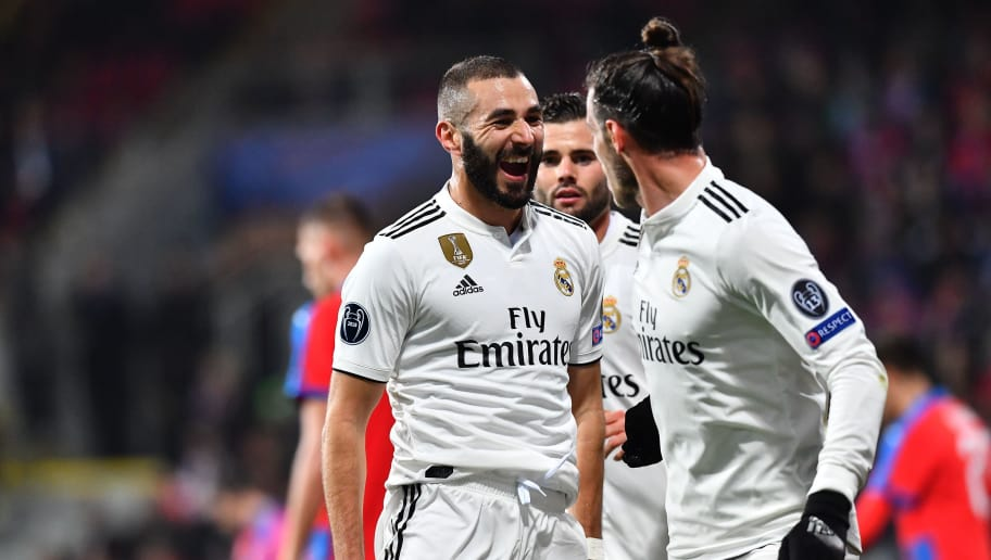 Real Madrid's French forward Karim Benzema celebrates with teammates after scoring during the UEFA Champions League group G football match Viktoria Plzen v Real Madrid in Plzen, Czech Republic on November 7, 2018. (Photo by JOE KLAMAR / AFP)        (Photo credit should read JOE KLAMAR/AFP/Getty Images)