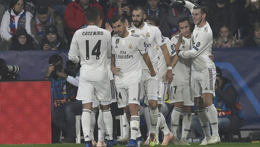 Real Madrid's French forward Karim Benzema (C) and teammates celebrate after their team scored during the UEFA Champions League group G football match Viktoria Plzen v Real Madrid in Plzen, Czech Republic on November 7, 2018. (Photo by Michal CIZEK / AFP)        (Photo credit should read MICHAL CIZEK/AFP/Getty Images)